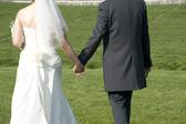a bride and bridegroom hand in hand after the marriage ceremony